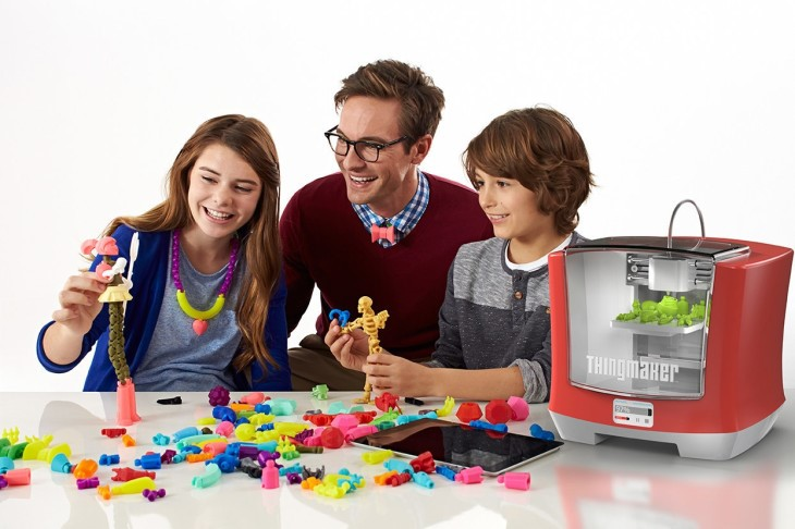 kids and teacher with 3d printer